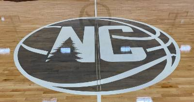 The logo of North Country Community College at center court in the college gymnasium