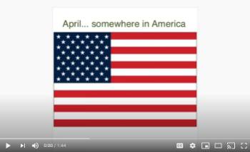 An image of the start of a video showing an American flag and the words April....somewhere in America