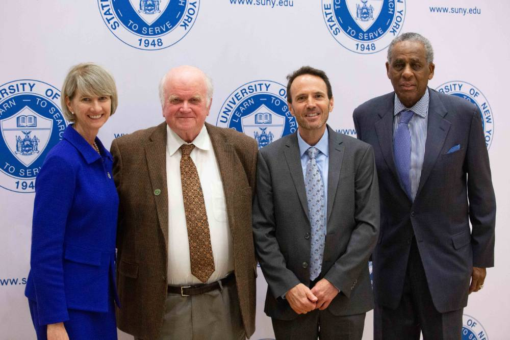 From left, SUNY Chancellor Kristina Johnson, NCCC Board of Trustees Chairman Steve Reed, new NCCC President Joe Keegan, and SUNY Board Chairman H. Carl McCall