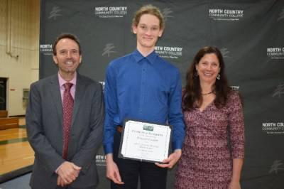 A student receiving an award