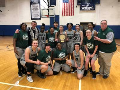 NCCC women's basketball team celebrates its Region III championship.