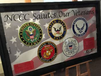 A display of military branch logos, honoring veterans, at the college's Malone campus