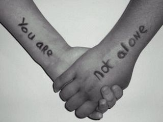 Two people holding hands with the words