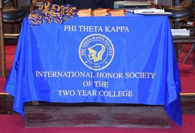 The PTK Banner displayed over a table.